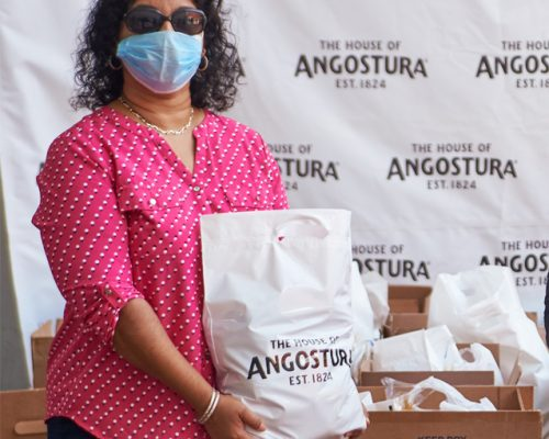 ANGOSTURA EMPLOYEES DISTRIBUTE  $1 MILLION  IN HAMPERS  TO FAMILIES ACROSS THE COUNTRY
