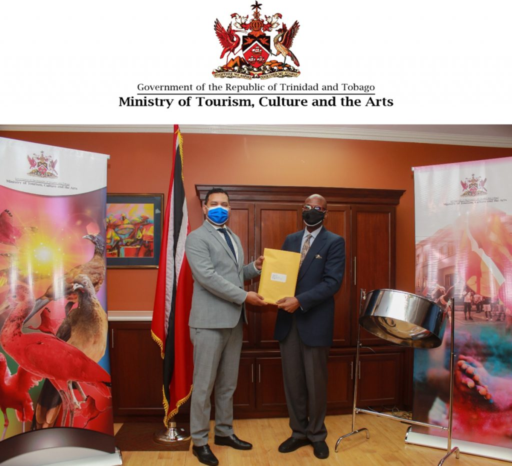 Minister of Tourism, Culture and the Arts, Senator the Honourable Randall Mitchell (left) presents the Instrument of Appointment to the new Chairman of the Board of Tourism Trinidad Limited (TTL), Cliff Hamilton.